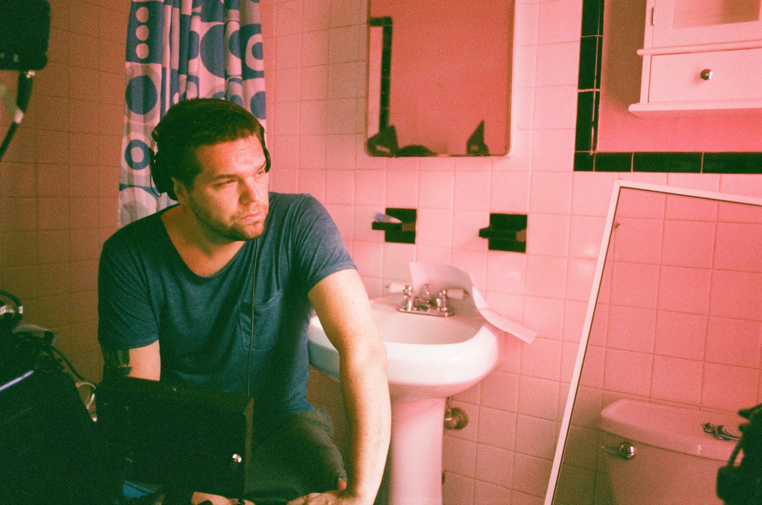 Dan Mixing in a Pink Bathroom