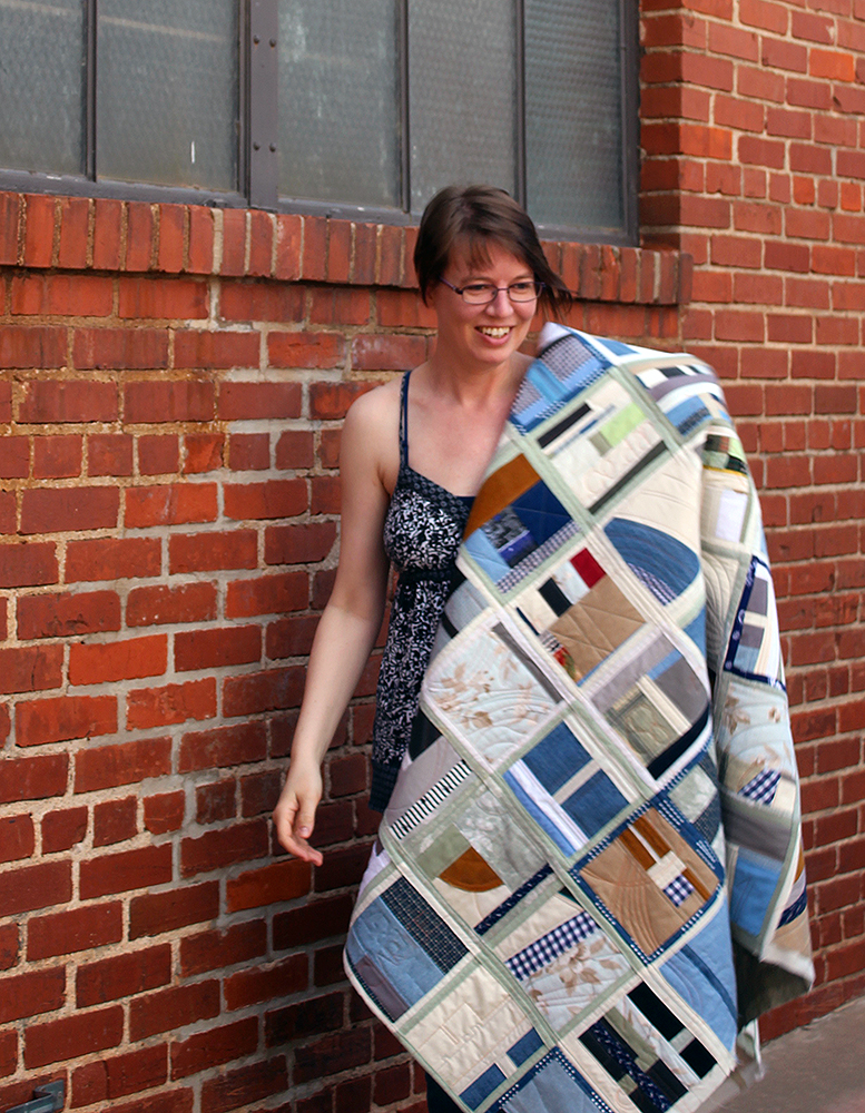 Sarah Atlee with finished quilt