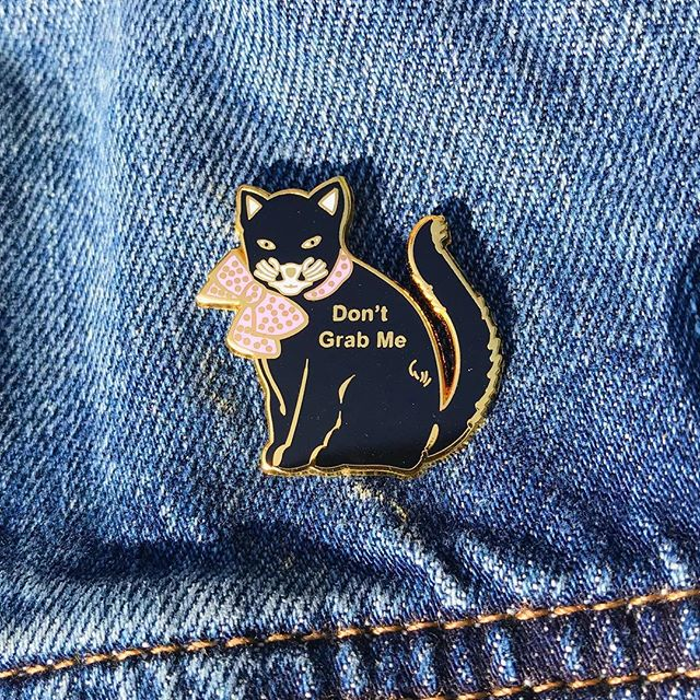If we don't mention #internationalcatday Facebook/Instagram is going to shut down our account. Let's celebrate these fierce and independent creatures. #meow #dontgrabme #pussygrabsback #resist #feminism #feminist #enamelpin #enamelpins #instafashion #blackcat #blackcats #instacats #catsofinstagram #drumpf #drumpfdotwtf #donthecon #notmypresident #usa #vote