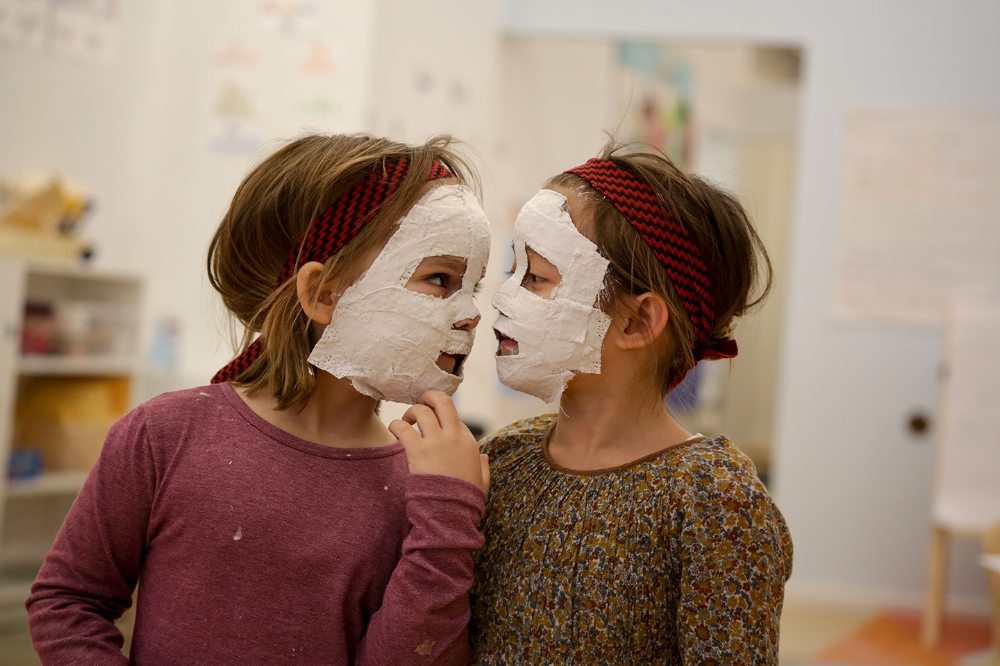 Issa and Tiana wait for their masks to set - part of our project that we are excited to share in our next exhibition night!