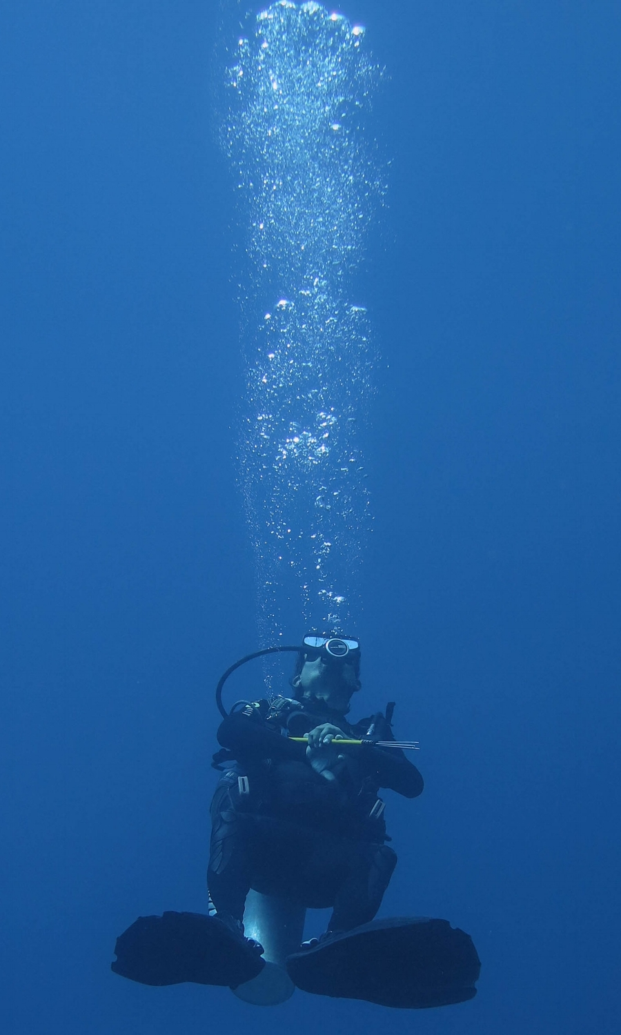One of Alex's happy dive certification students enjoys his new-found skills on a dive vacaction in Roatan, Honduras.