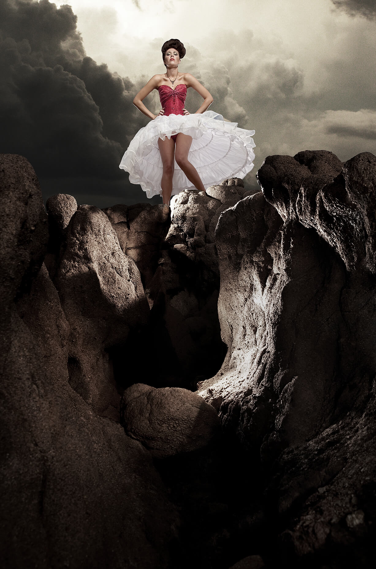 Surreal fashion photograph of girl in hooped dress and corset