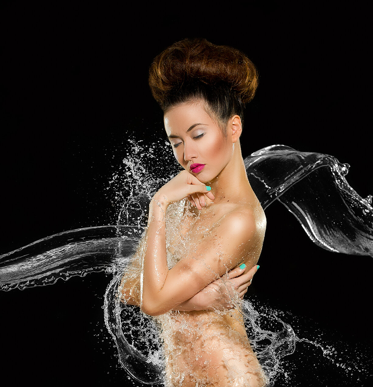 nude model photograph with high speed flash to freeze water droplets
