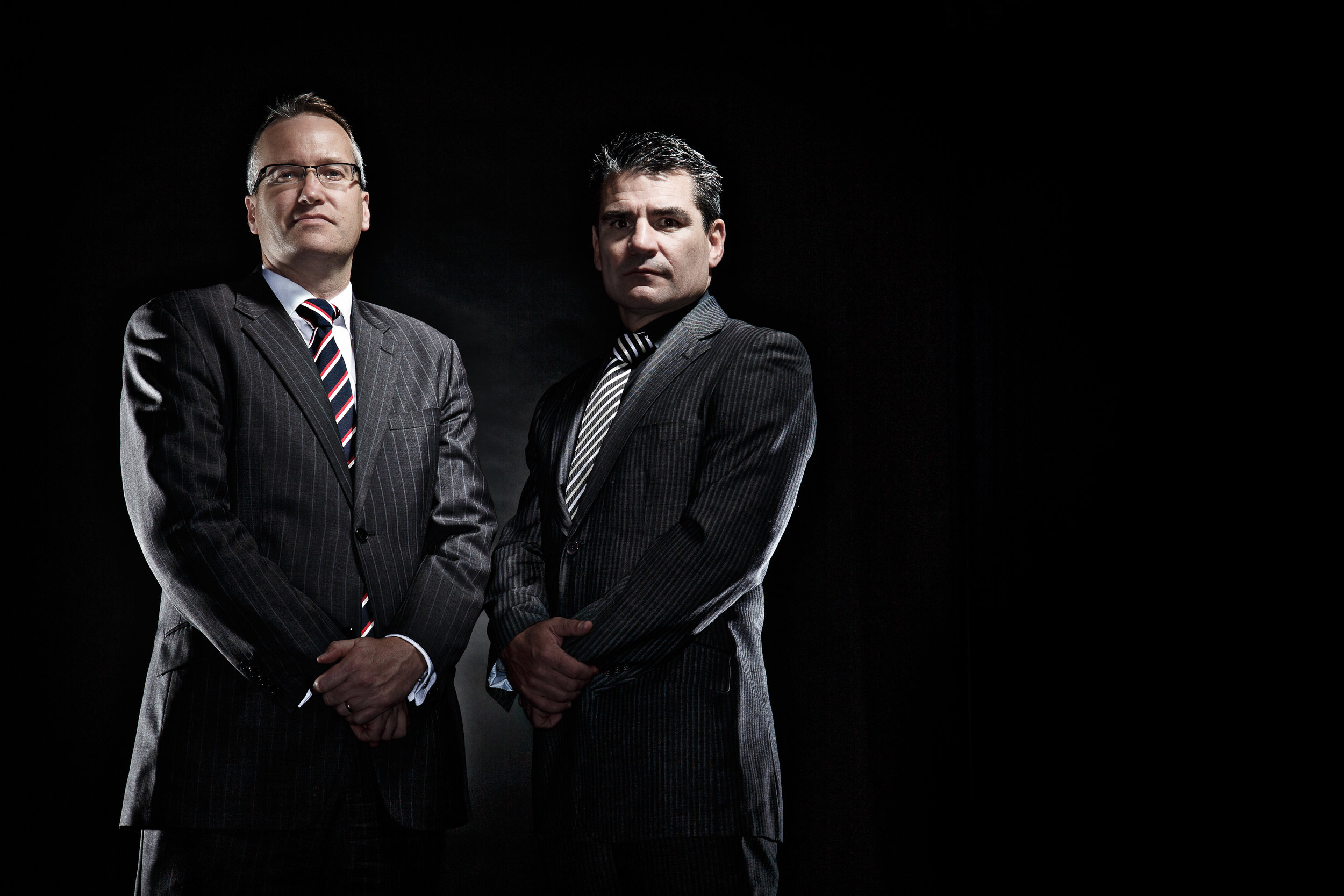 Editorial portrait photograph of two police detectives looking strong and dominant