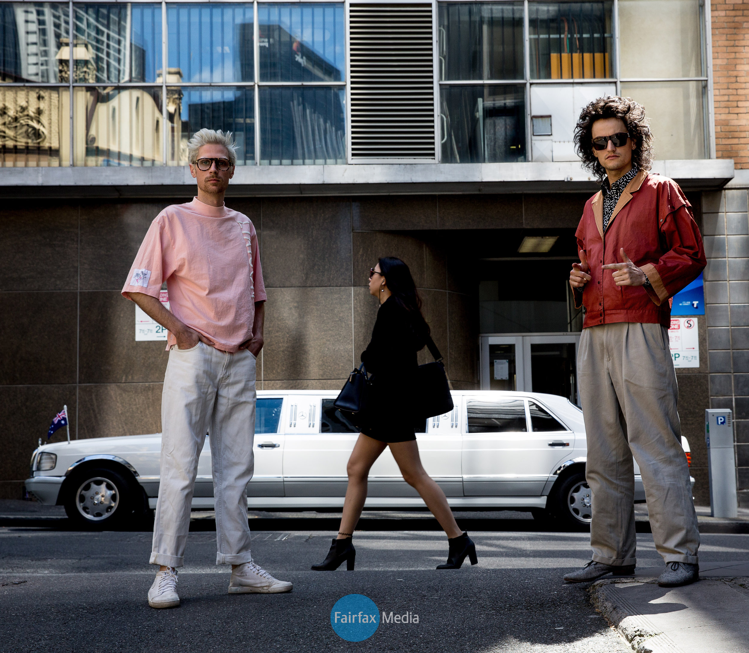 band members of client liaison posing downtown Melbourne city with limo in background