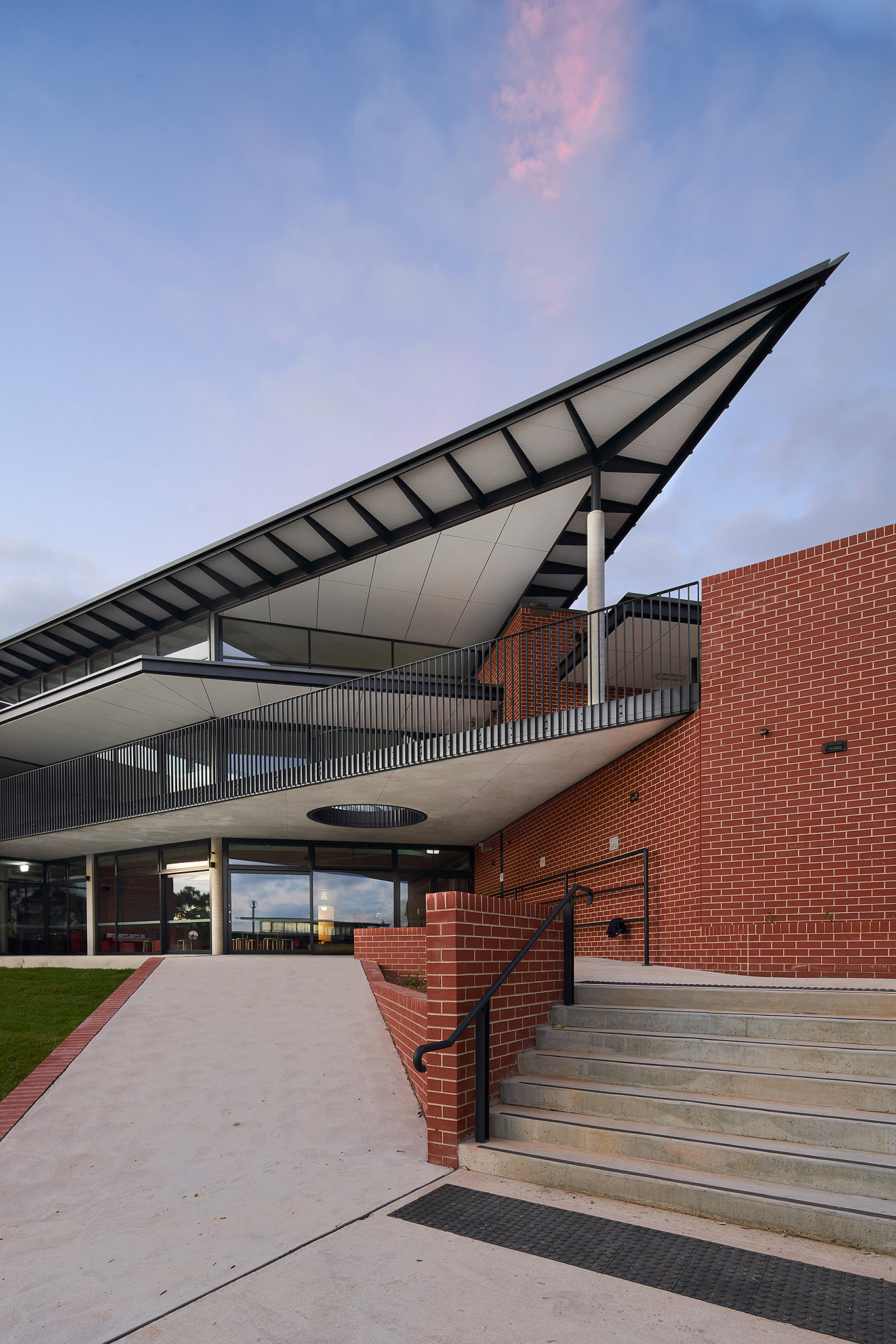 Two point perspective photograph of an architect designed building with dramatically angled roof