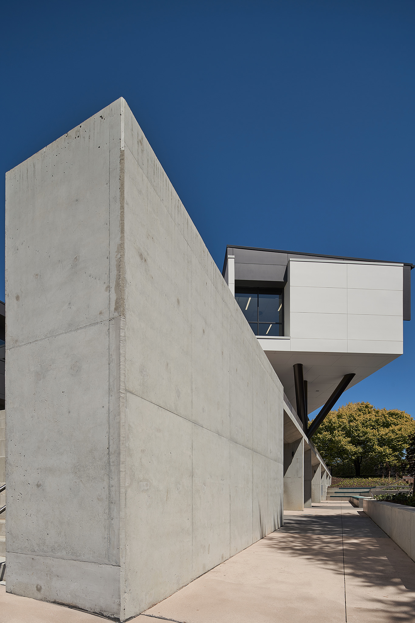 bold concrete design with cantilever building behind