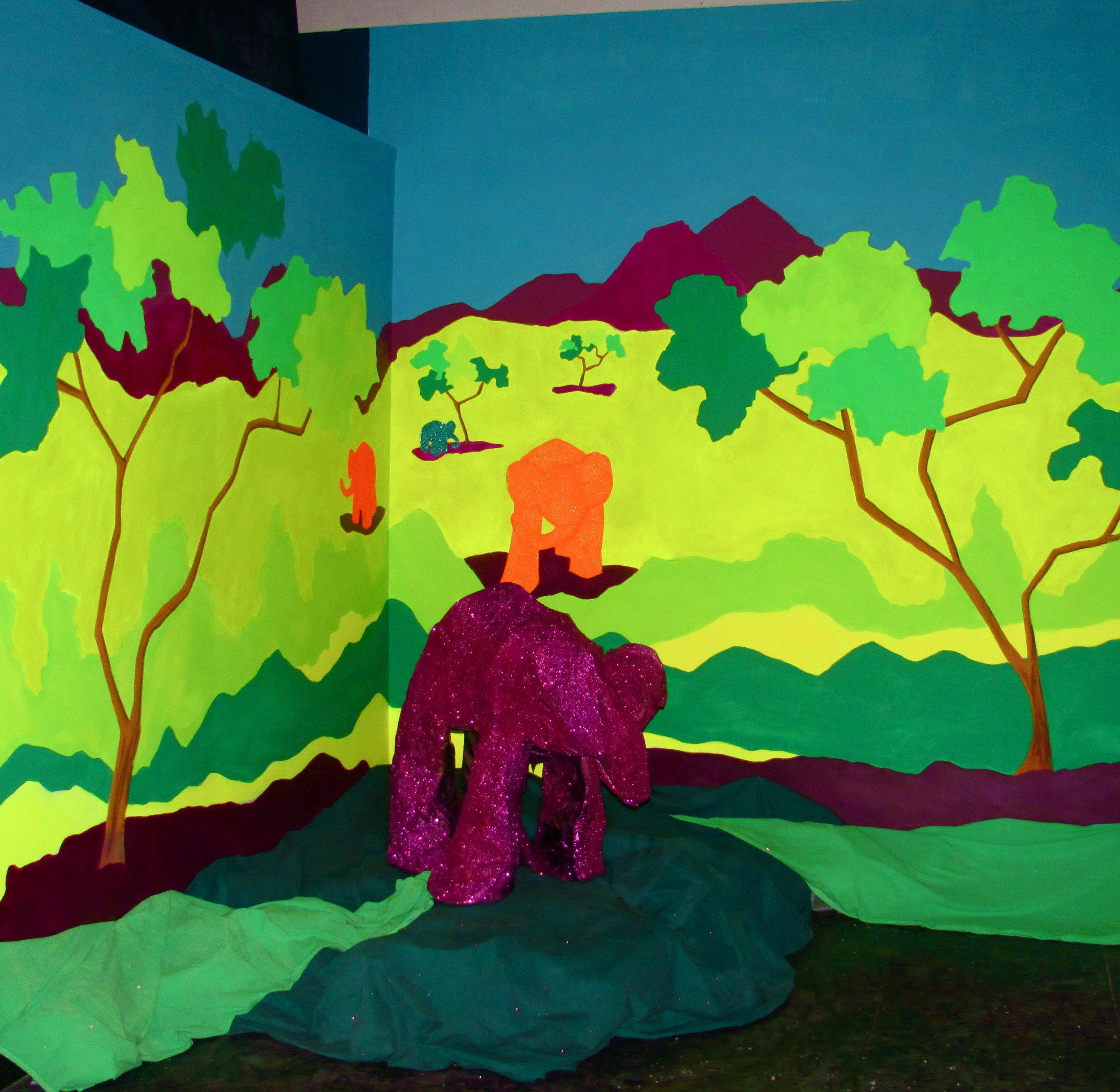 Glitter elephant habitat mural.  Materials: glow in the dark paint, glitter