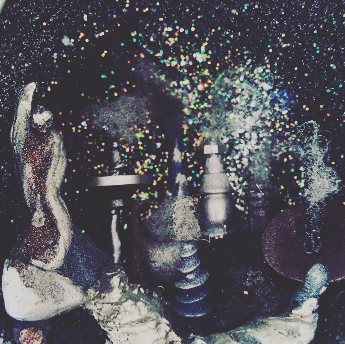 Detail of orb city. Materials: found objects, glitter