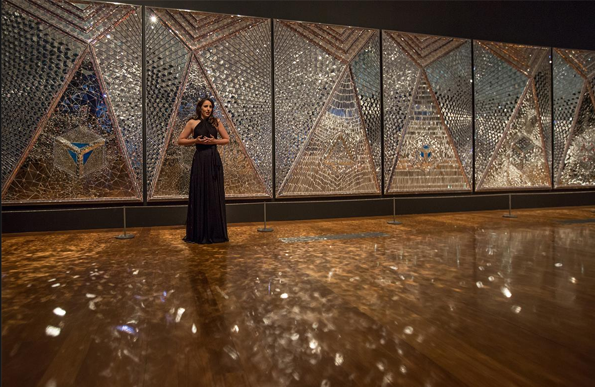 Katie Stenzel performing as part of Sensory at GOMA, 2017, feat. Monir Shahroudy Farmanfarmaian's Lightning for Neda 2009. Image by Stephen Henry