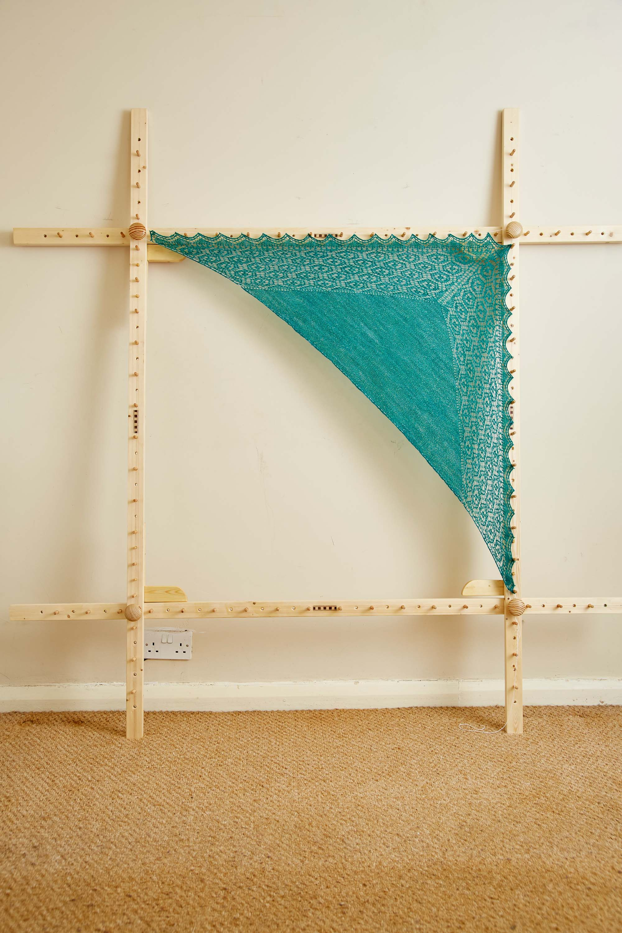 Once you've looped the cotton over all of the pegs, leave your hap to dry.