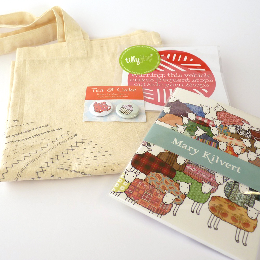 First prize in the knitalong this month is a stack of goodies! Mary Kilvert badges and sheep notebook, along with a Tilly Flop Warning sticker, as well as a much sought-after Edinburgh Yarn Festival embroiderable tote bag, kindly donated by Jo and Mica of EYF.