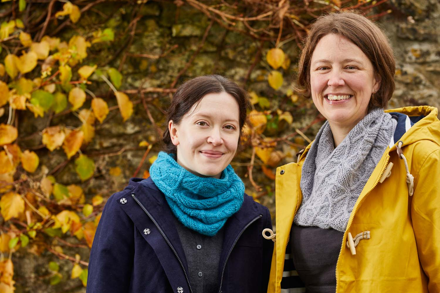 Lucy is wearing the short cowl knitted in shade Anemoi and I am wearing the longer version, knitted in Minos (pale grey). Image © Jesse Wild.
