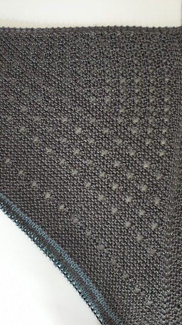 Melanie (mjdeboeck on Ravelry) is also using the original colours of Joji's design, but has decided to add her own twist to  her Sterlyn Shawl  by playing with the eyelet spacing — what a fun idea!