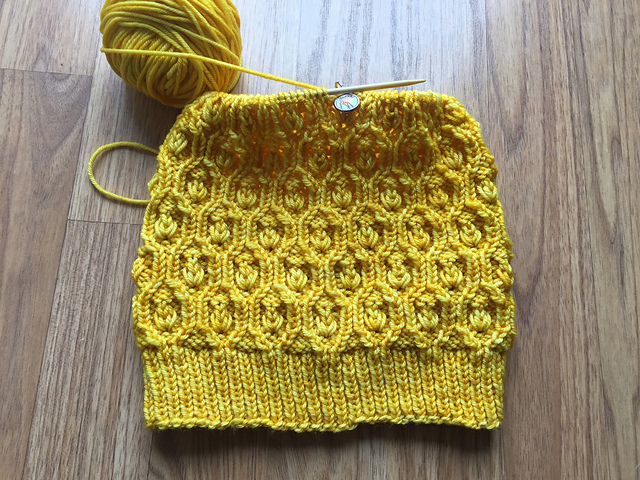 Nancy's (layingcable on Ravelry)  sunny version  shines in one skein of  Vivacious DK, shade Sunshine  (of course!)