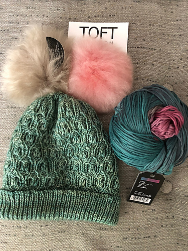 Elizalit  weighs pompom options for her hat (knit in the  Seaglass shade of Vivacious DK ) and considers yarn for a matching  Bramen Cowl .