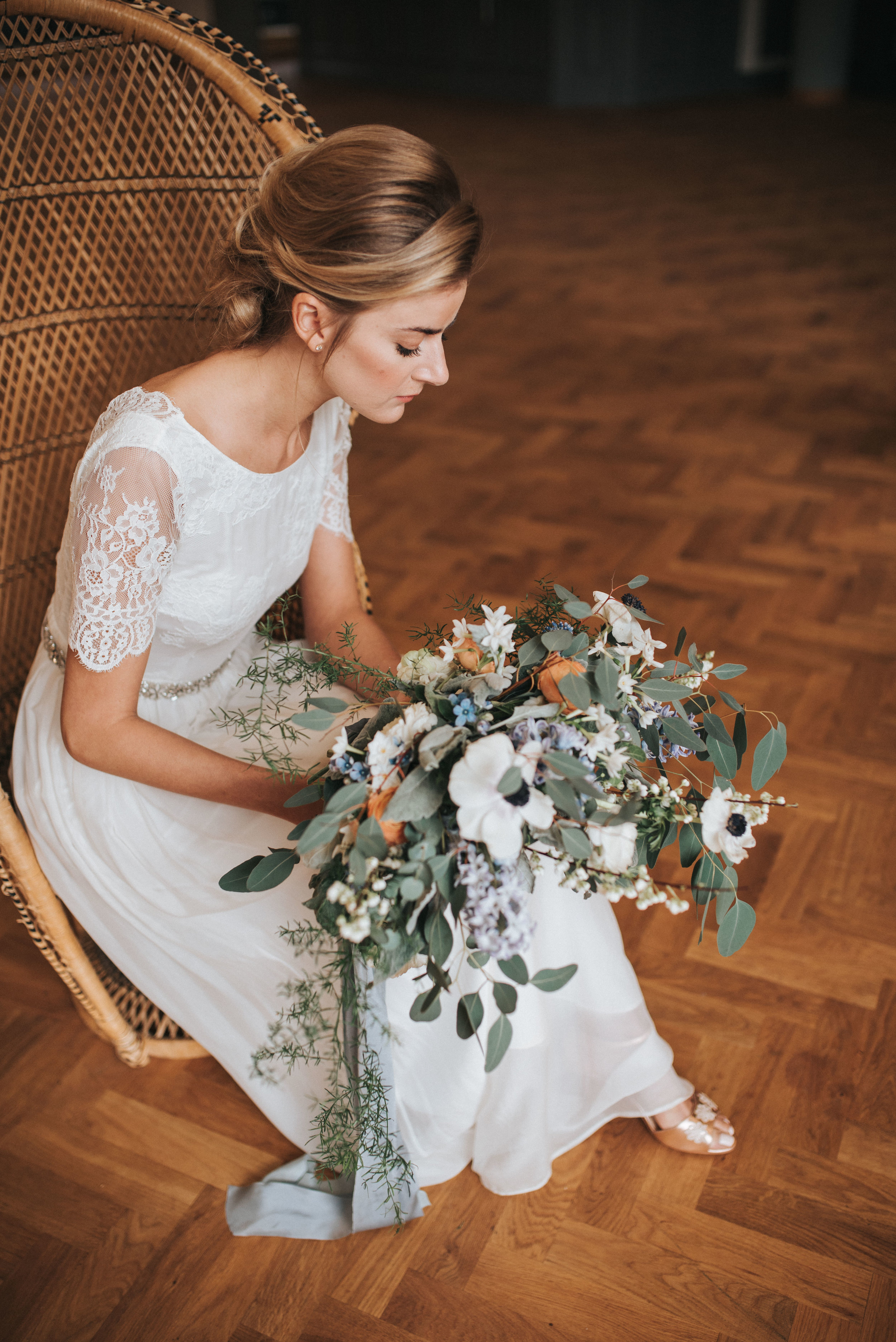 Girl sat on chair with bouquet of a floral and flowery church design.jpg