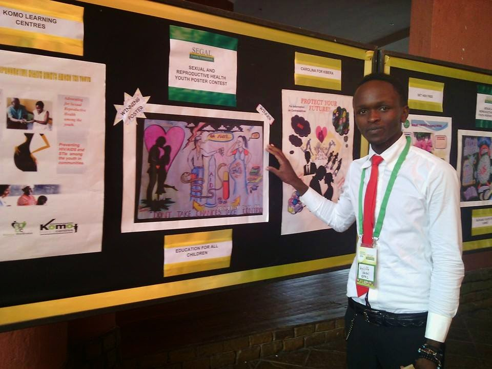 Wycliffe Displaying his Poster at the Segal Family Foundation Annual Meeting