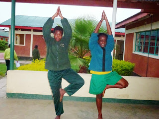 Ann Sammy is on the left doing Tree Posture