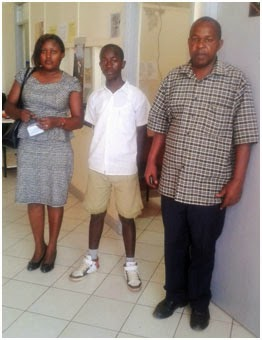 Benard Mwengi with his teachers at the EFAC office, Africa Nazarene University