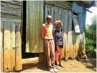 Eric Wainaina and his mother in Kahara Village