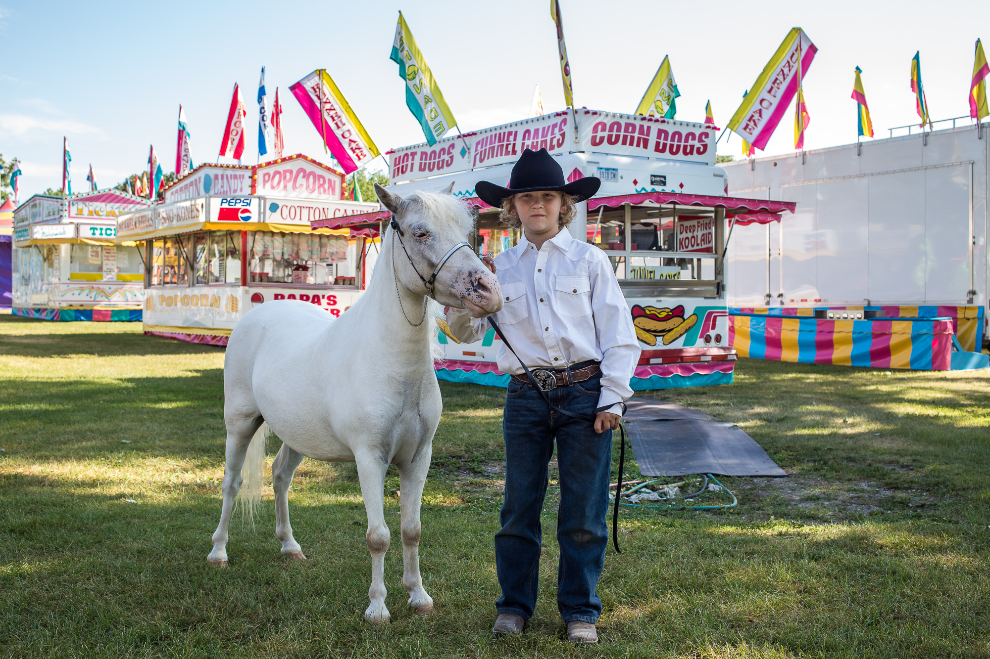 Gage Koster, 11, with Chase, a miniature Appaloosa, at the Hamilton County Fair on Wednesday, July 24, 2013 in Webster City, IA.