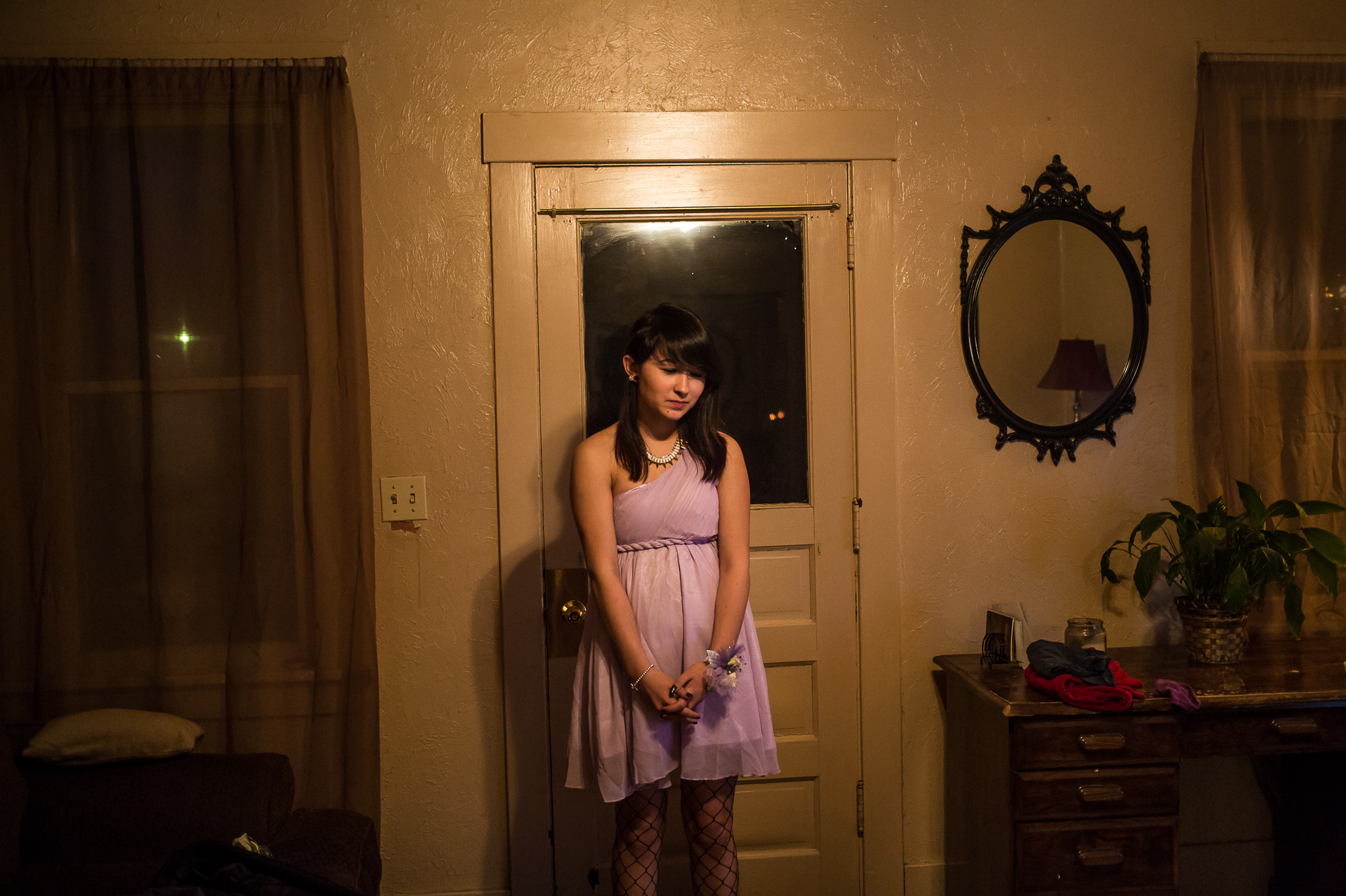 Katie waits for her prom date on Saturday, April 27, 2013 in Webster City, IA.