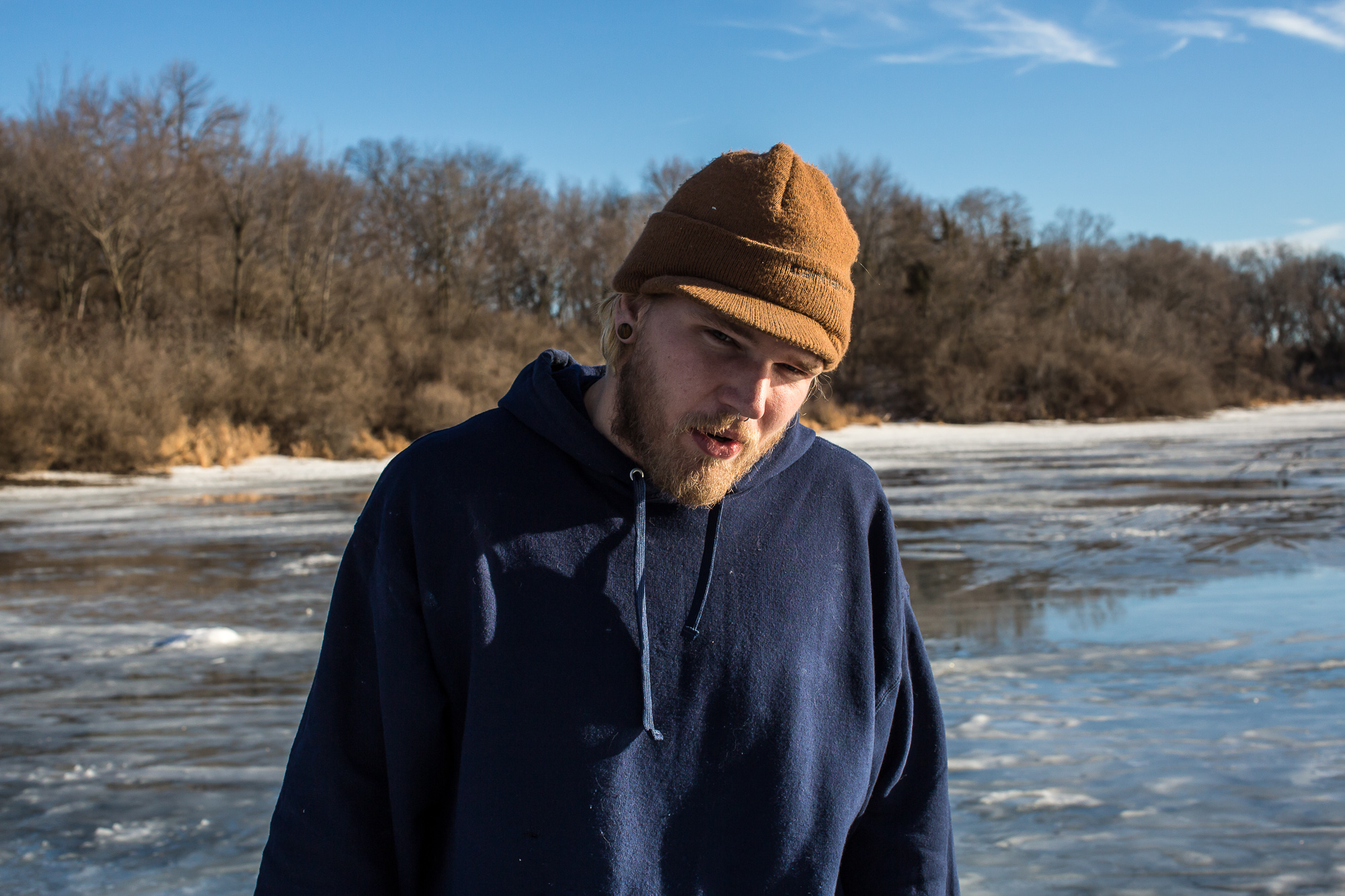 Jesse Smith ice fishing at Briggs Woods pond on Sunday, January 19, 2014, in Webster City, IA.