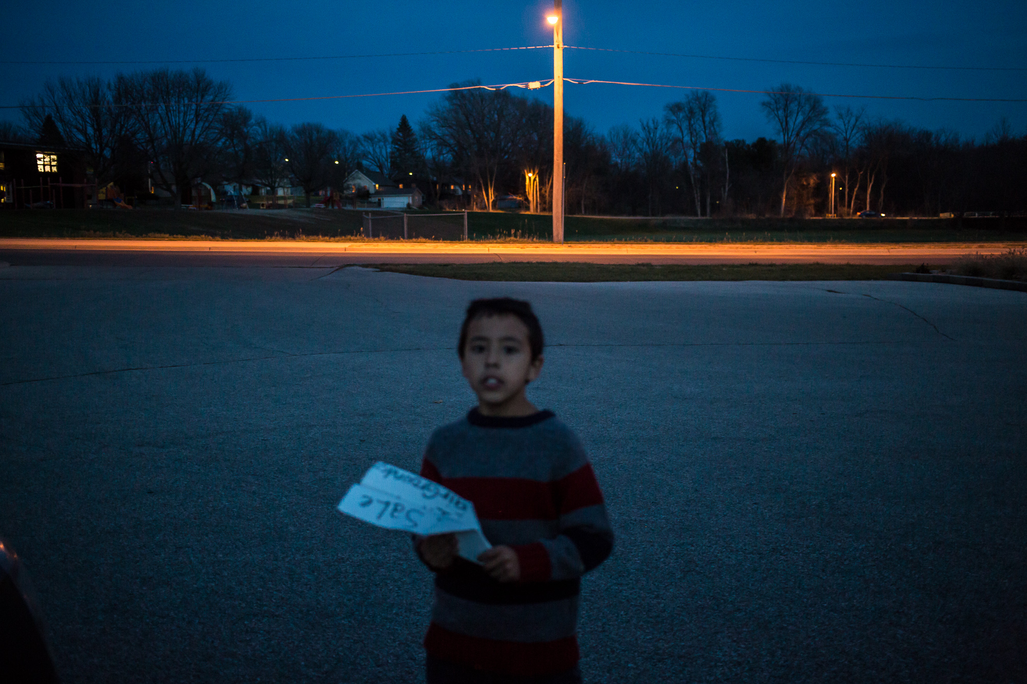 Riley Jensen holds a paper airplane made from a sign he found on Wednesday, November 14, 2012 in Webster City, IA.