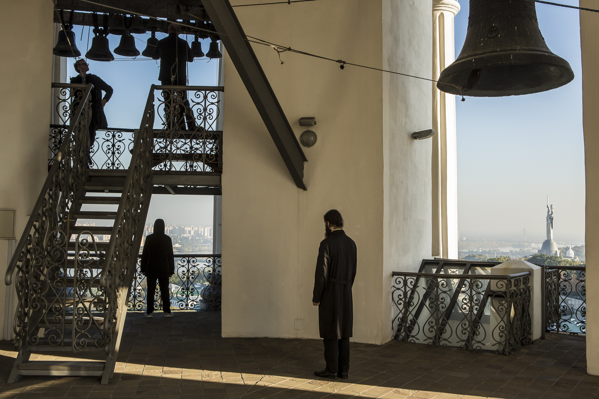 People listen to the ringing of the bells inside the Great Lavra Bell Tower at the Kyiv-Pechersk Lavra on Wednesday, October 10, 2018 in Kyiv, Ukraine.