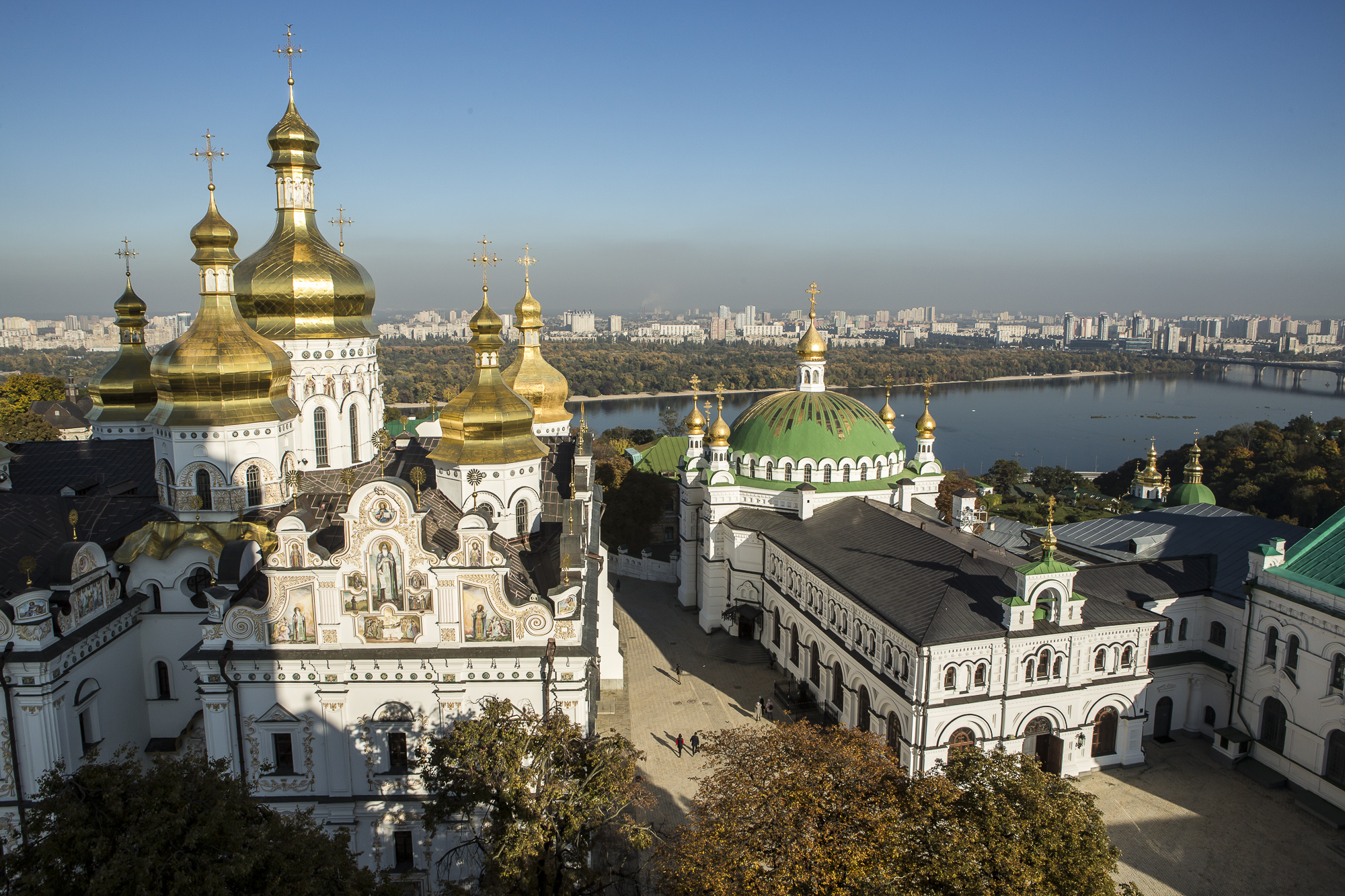 The Holy Dormition Cathedral, left, and the Refectory Church of Sts. Anthony and Theodosius as seen from the Great Lavra Bell Tower at the Kyiv-Pechersk Lavra on Wednesday, October 10, 2018 in Kyiv, Ukraine.