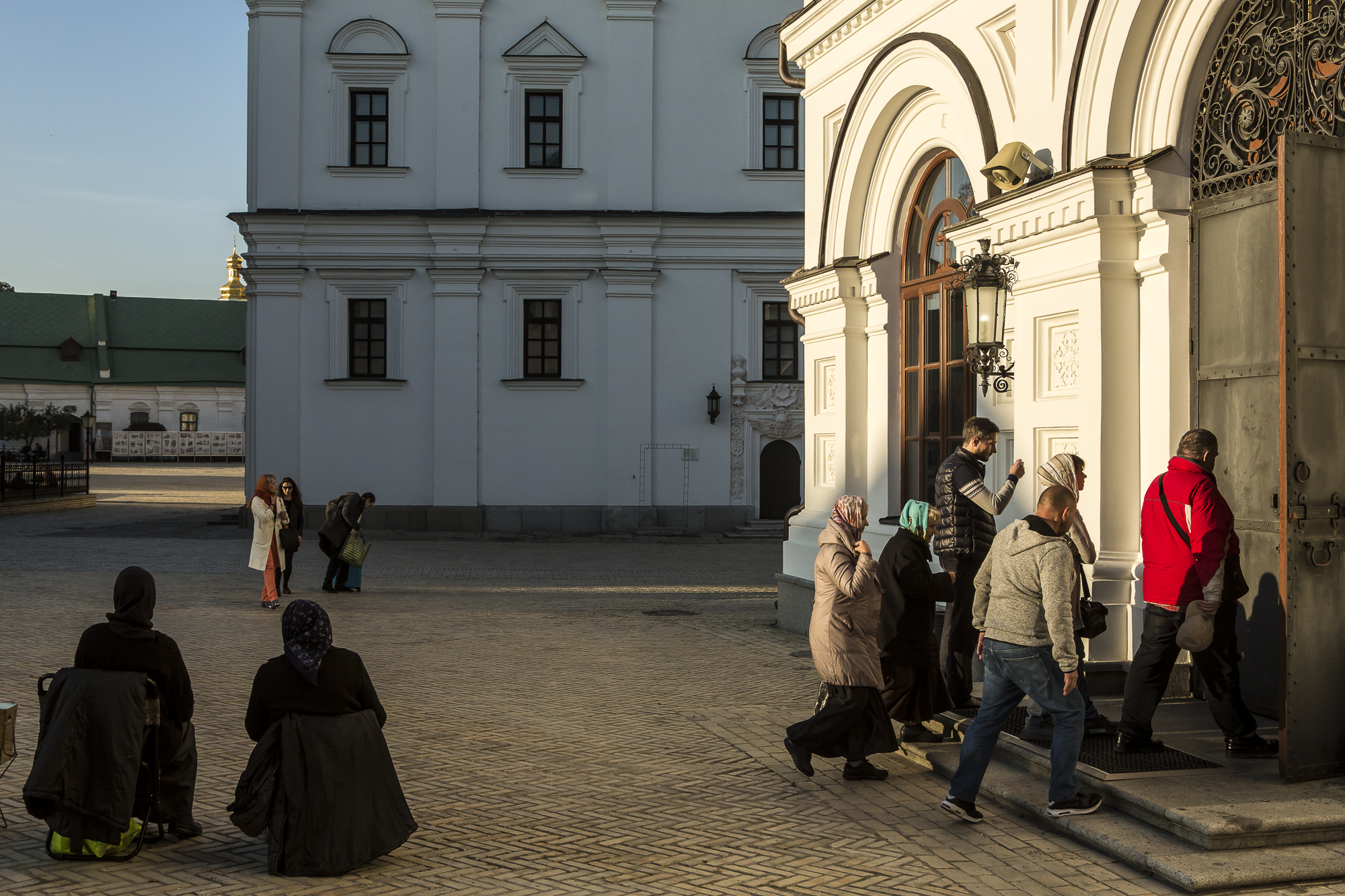 People enter the Refectory Church of Sts. Anthony and Theodosius for the Evening Divine Office at the Kyiv-Pechersk Lavra on Wednesday, October 10, 2018 in Kyiv, Ukraine.