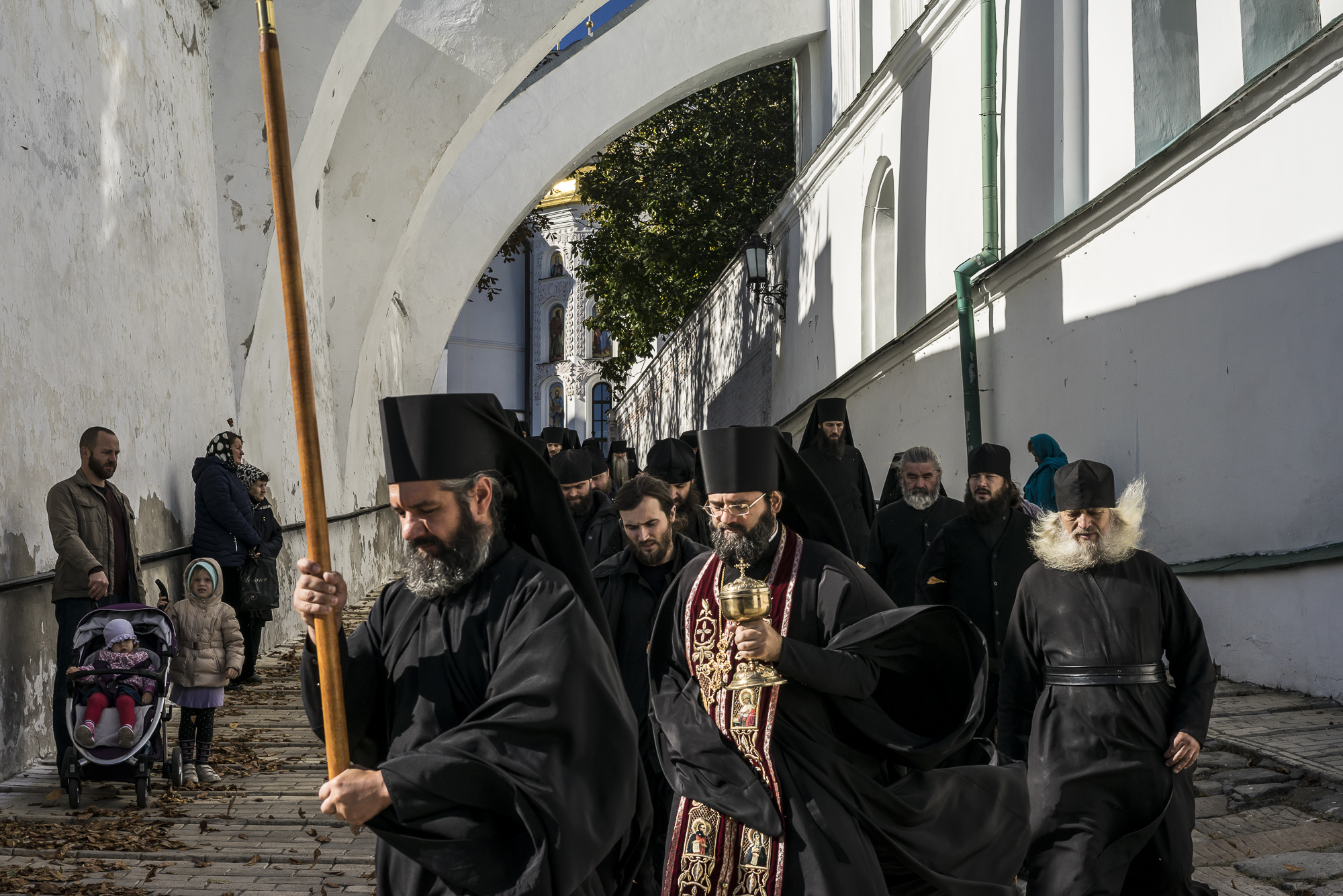 Monks process from the Refectory Church of Sts. Anthony and Theodosius to the refectory for a communal meal at the Kyiv-Pechersk Lavra on Sunday, October 7, 2018 in Kyiv, Ukraine.