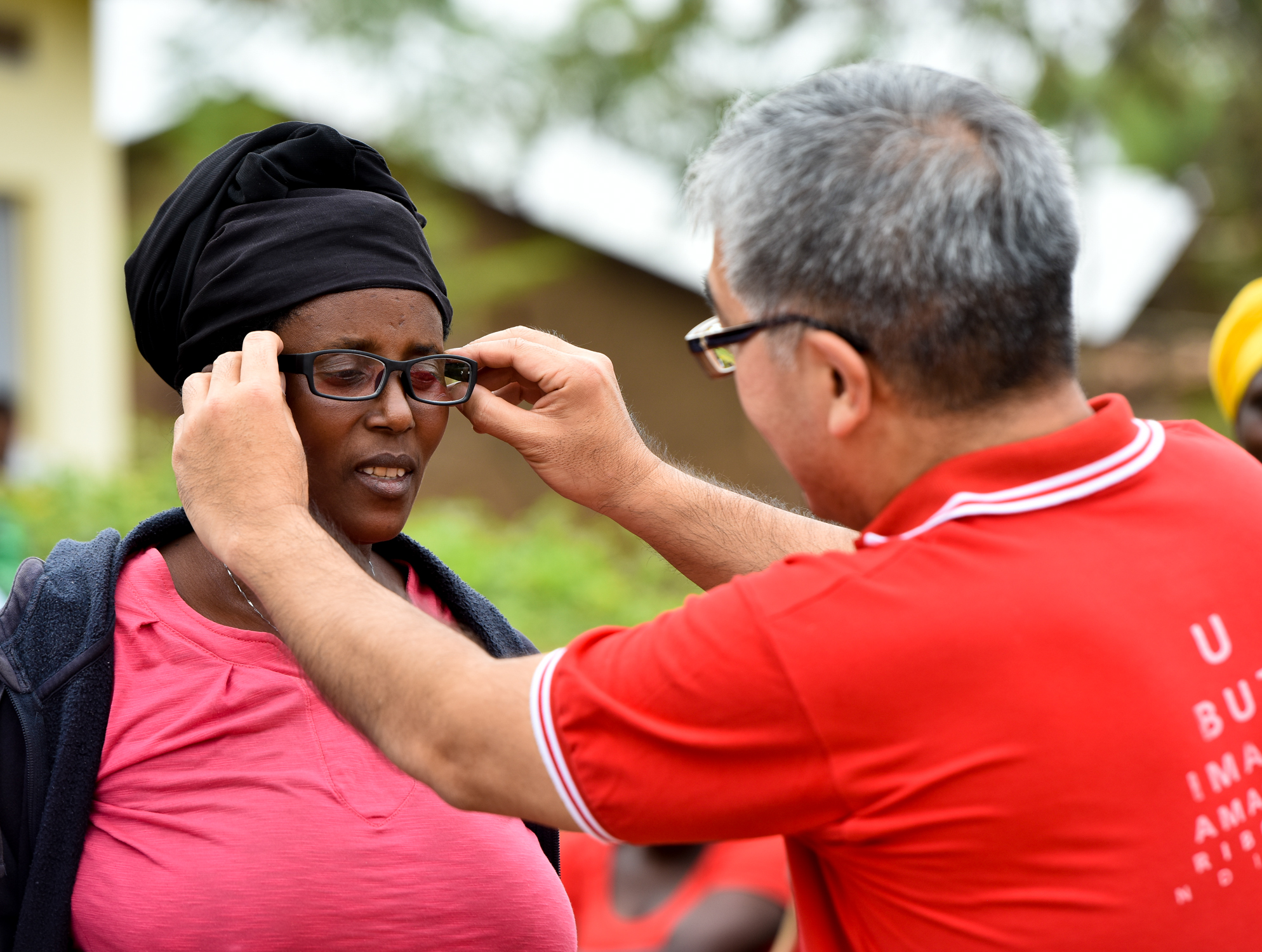 James Chen founder of VFAN and Clearly visits Rwanda to celebrate 2 millionth eye screening.jpg