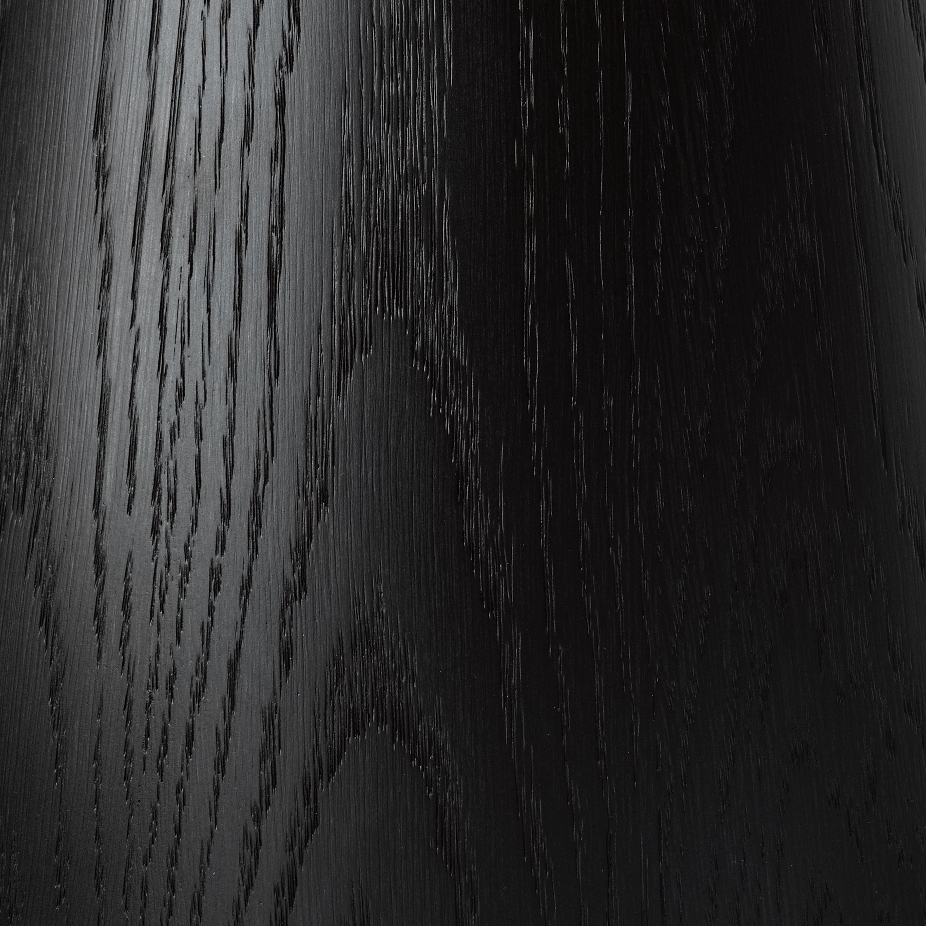 EBONISED OAK - Stained to a deep black, and lightly brushed to leave the grain open and visible. Finished with a clear lacquer to a 10% sheen level.