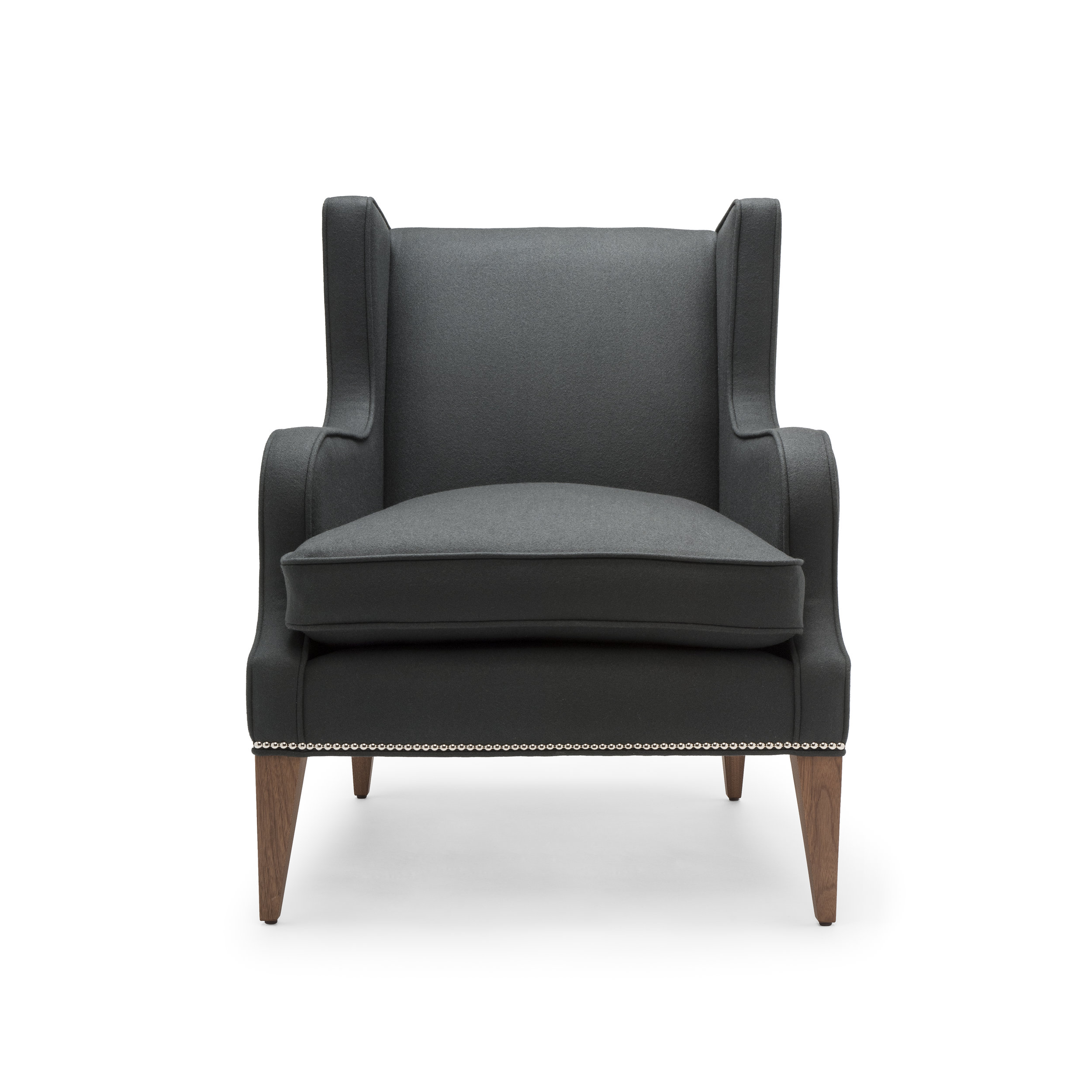 the alae lounge chair - The Alae lounge chair features sleek sculptural lines. The seat is softened perfectly with a luxurious feather and down wrapped cushion. Upholstered in charcoal wool (100% British), with legs in natural oiled walnut and decorative nails in polished nickel. ♦ Construction: solid beech frame, sprung seat and webbed back with a feather and down wrapped seat cushion.♦ Height: 88cm | Width: 70cm | Depth: 91cm | Seat Height: 45cm♦ Hand Signed No. 399Trade Price: £1,350 + vatQty:1