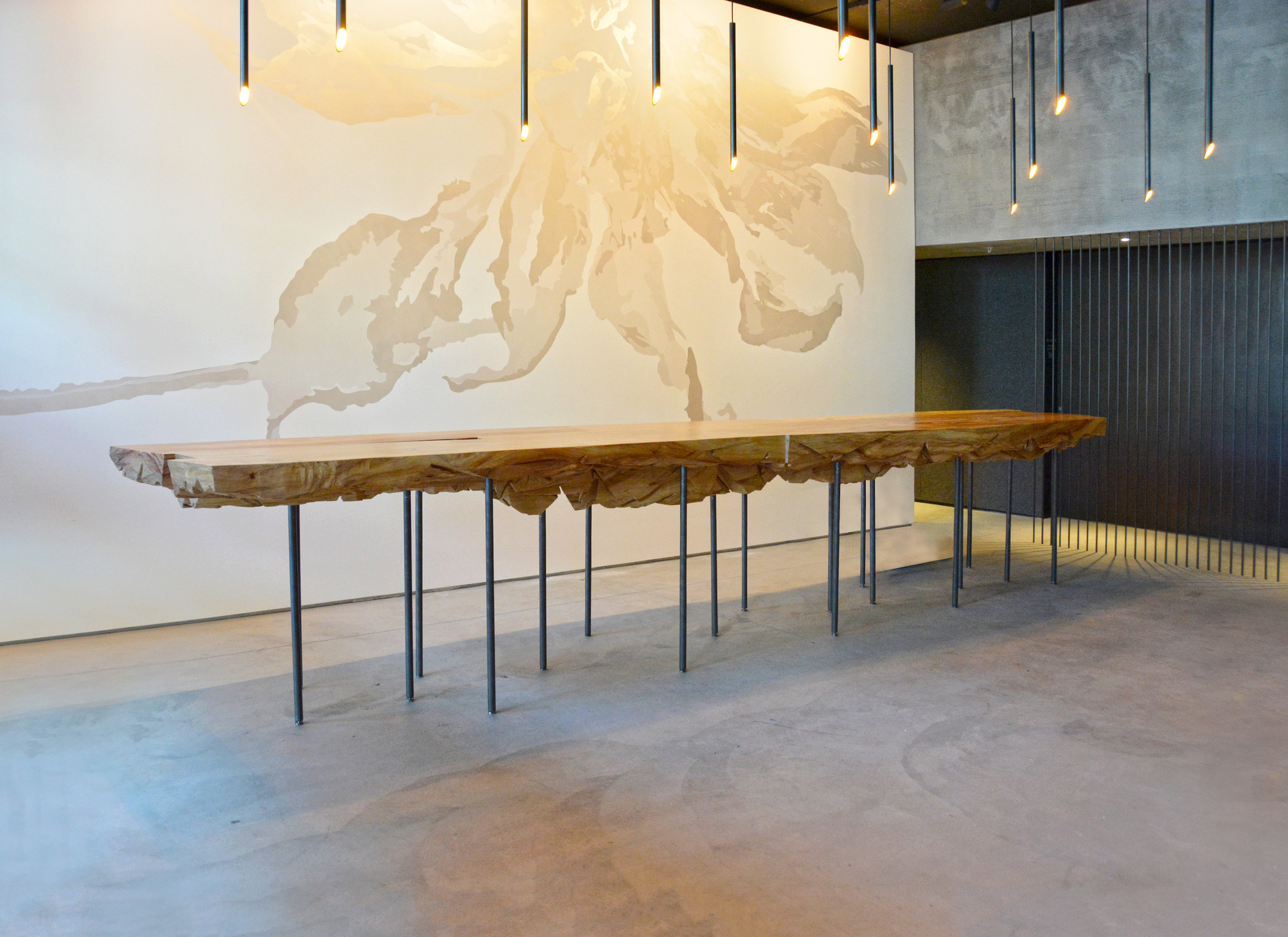 """POST-INSTALLATION OF THE FIRST COTTONWOOD SHARD TABLE TO ENTER THE BUILDING. SUPPORTED BY 1"""" STEEL RODS MADE IN-HOUSE."""