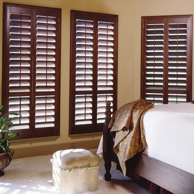 Stained wood shutter with standard Alta casing