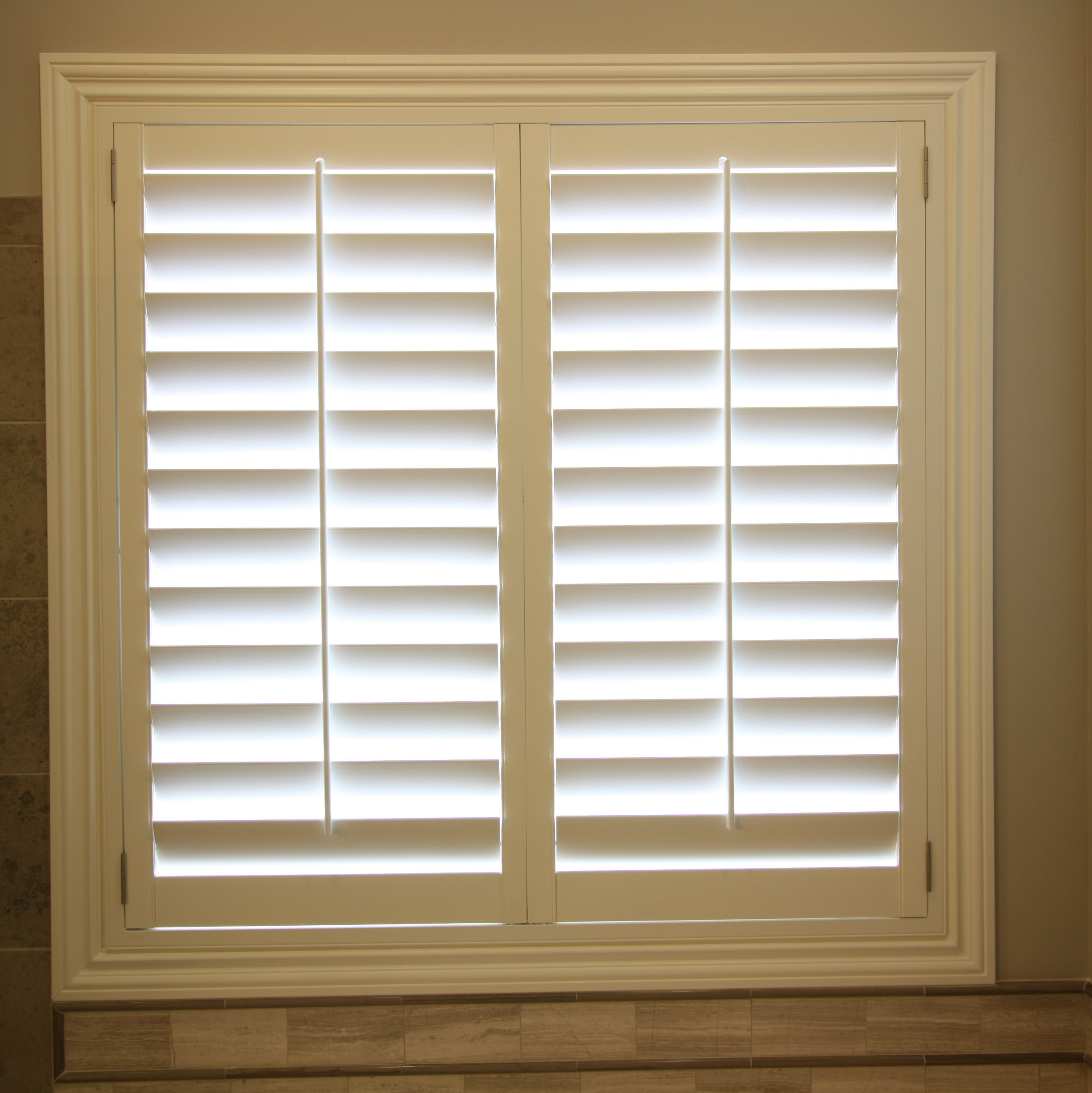 Wood shutter with small Z casing in previously cased window