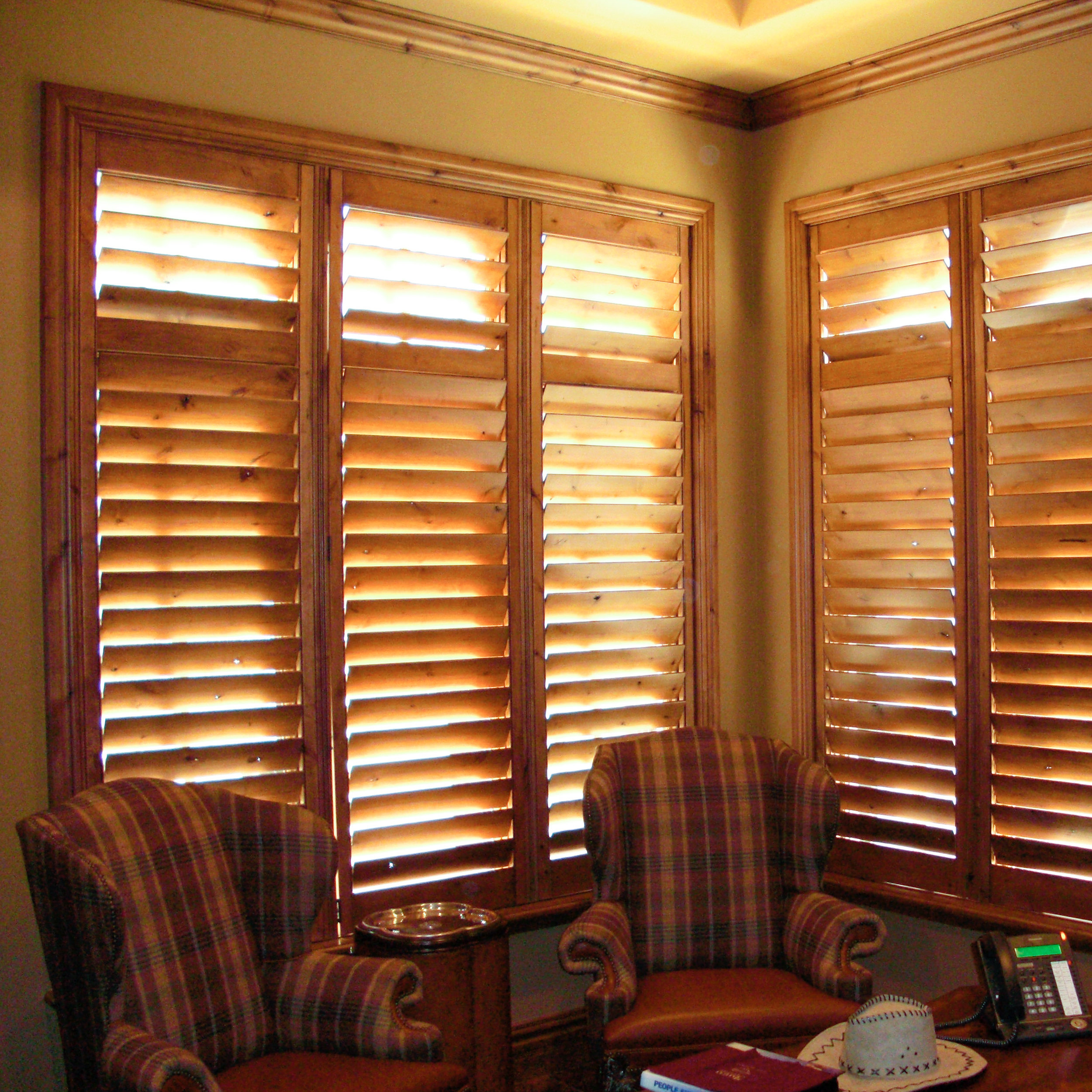 Stained wood shutter with divider rail, hidden tilt and upgraded Alta casing