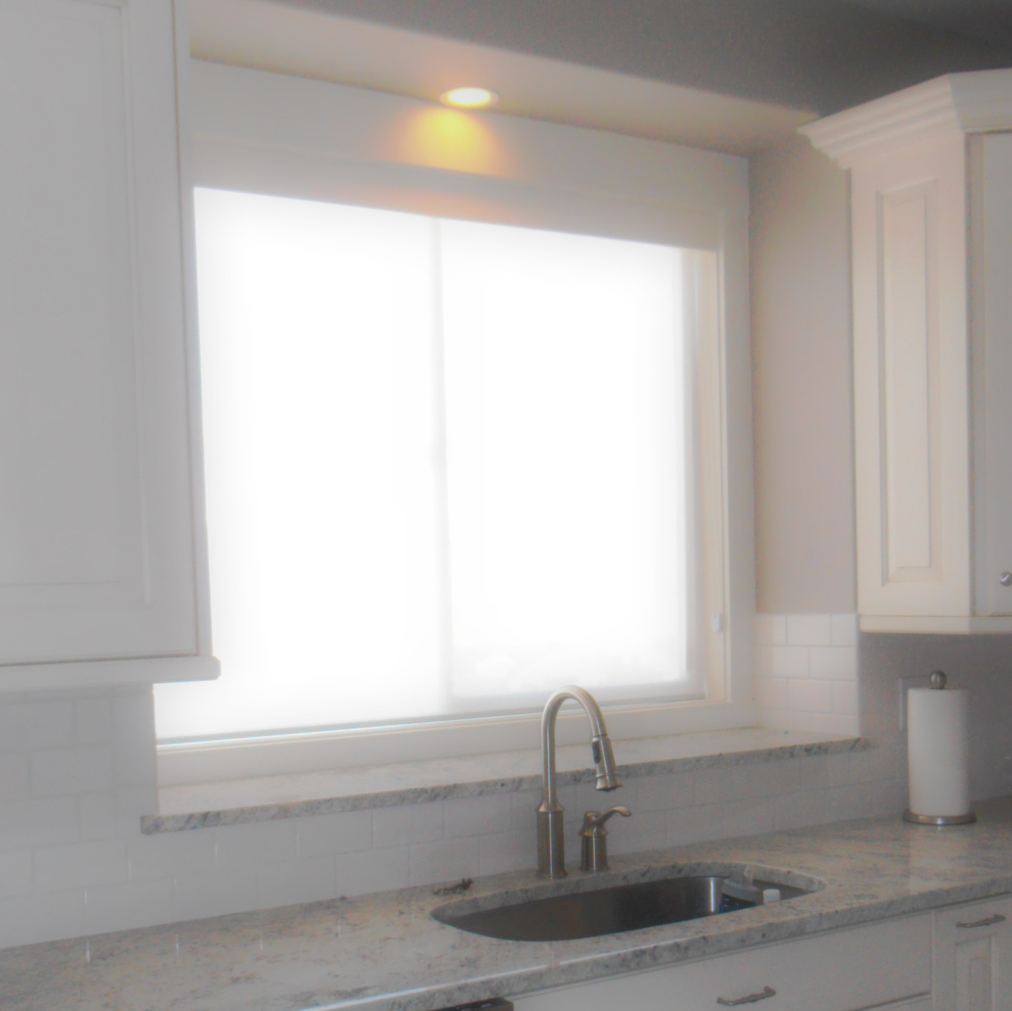 Light filtering roller shade closed with cassette valance