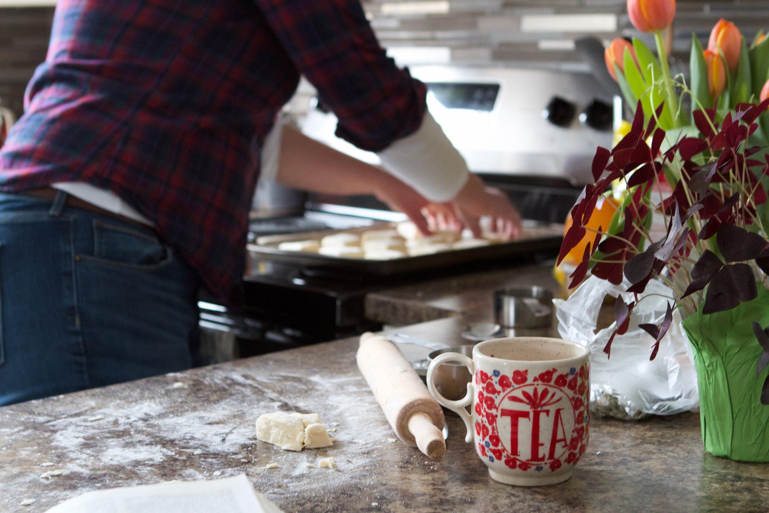 tea mug hands on biscuits.jpg