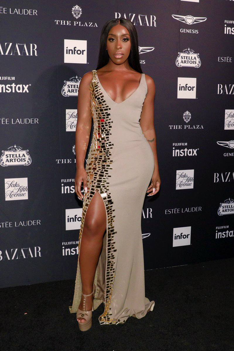 Jackie Aina looking stunning in CD Greene gown at the Harpers Bazaar Icons Party  2018