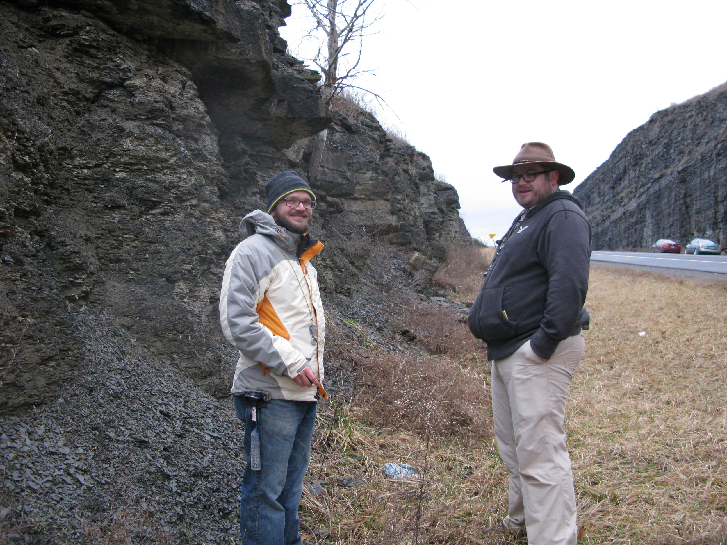 Figure 2. Photo of my advisor Dr. Andrew Bush (left) and myself (right) at an Upper Devonian outcrop near Tioga, PA. The shale is the Pipe Creek Formation, approximately the Lower Kellwasser extinction horizon