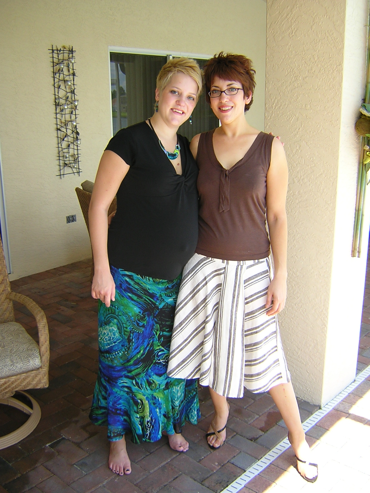 Just weeks from becoming a mom-- me (left) with my radiant sister.