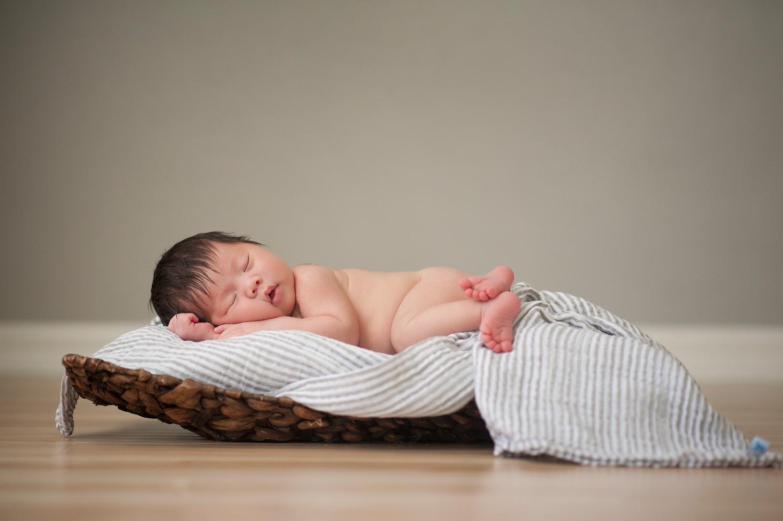 13-cute-chubby-baby-resting-pillow-studio-portrait.jpg