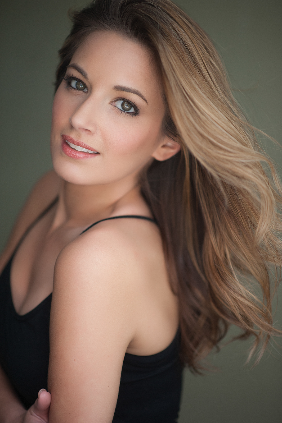 25-stunning-young-woman-headshot-makeup-wind-hair-captivating-eyes-megan-dipiero-photography-fort-myers-naples.jpg