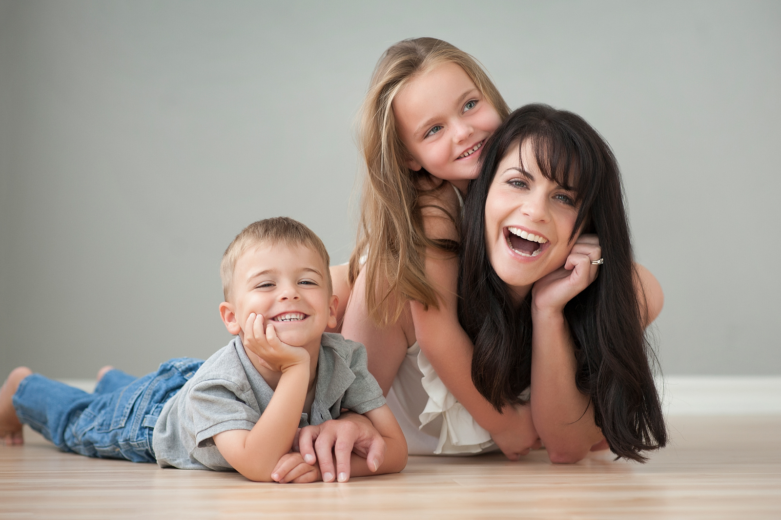 22-laughing-family-mother-children-laying-floor.jpg
