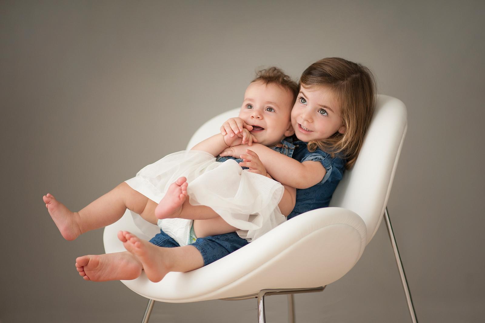 25-cute-baby-sisters-in-chair.jpg