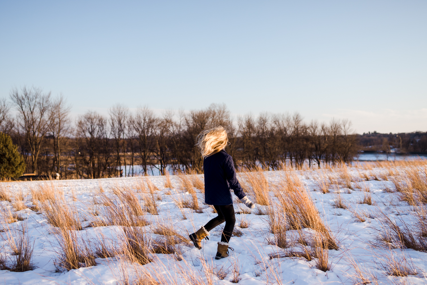 blonde tween girl in winter field - orono family photographer